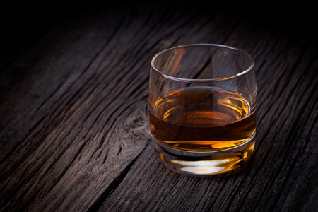Glass of luxury single malt whiskey  Drink concept photography taken on old wooden table  photo