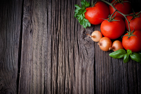 Fresh picked tomatoes and ketchup ingredients composition  Vegetables photography taken on rustic old table