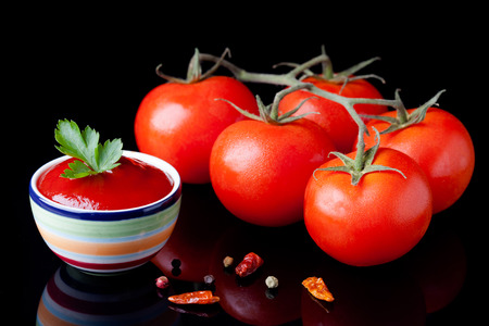 Fresh homemade ketchup and tomatoes composition  Vegetables