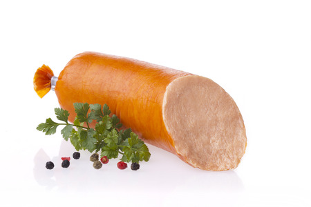 Fresh polish meat spread sausages. Pate composition taken on white background with reflection.