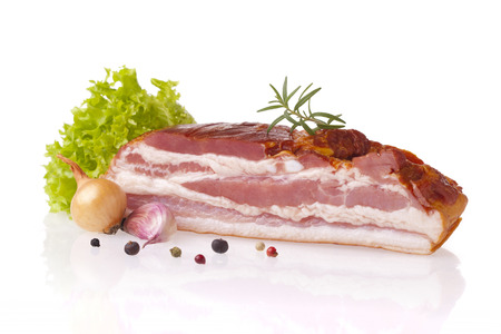 Fresh smoked polish bacon. Meat composition taken on white background with reflection. Stock Photo