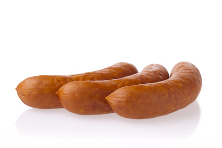 Fresh polish sausages. Meat composition taken on white background with reflection. Stock Photo