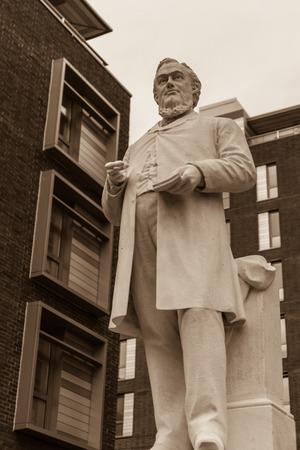sepia toning: ENGLAND, LIVERPOOL - 15 NOV 2015: Hugh Stowell Brown statue Hope Street