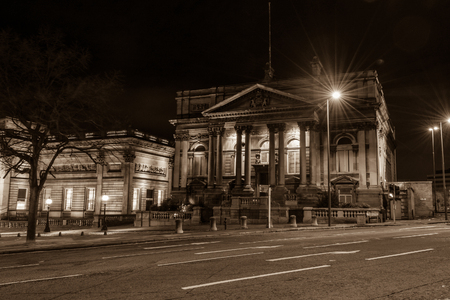 sepia toning: ENGLAND, LIVERPOOL - 15 NOV 2015: County Sessions House by night