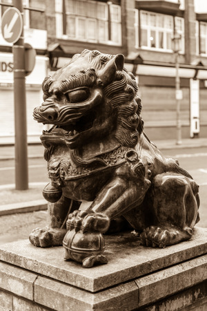 sepia toning: ENGLAND, LIVERPOOL - 15 NOV 2015: Chinatown - Chinese Lion A Editorial