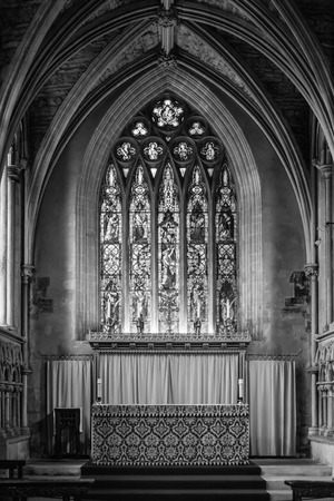 keystone: Stained Glass Window and Altar Elder Lady Chapel at Bristol Cathedral black and white vertical photography