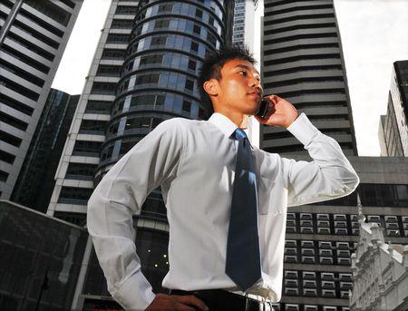 gprs: Guy with handphone Stock Photo
