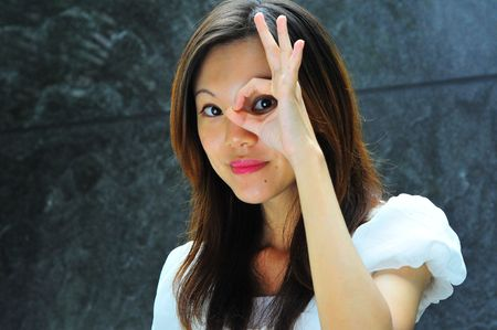 hand gestures: Asian Girl with Hand gestures - 1 Stock Photo