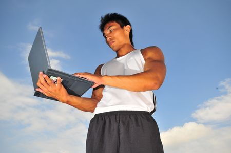 lap top: Male Sportsman using a laptop - 5