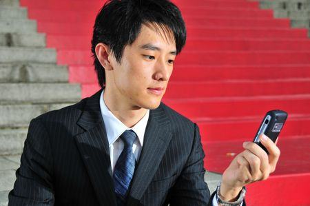 Business Man with PDA phone 6 photo