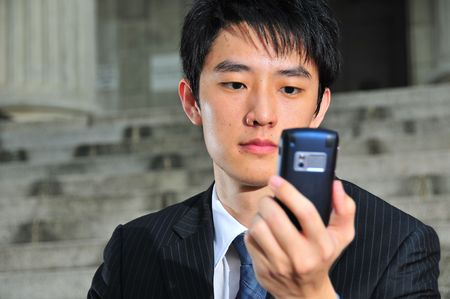 Business Man with PDA phone 5 Stock Photo
