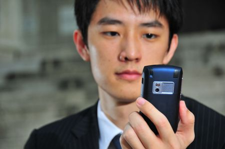Business Man with PDA phone 3 Stock Photo