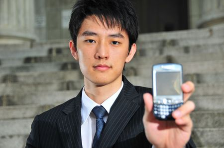 lap top: Business Man with PDA phone 2 Stock Photo