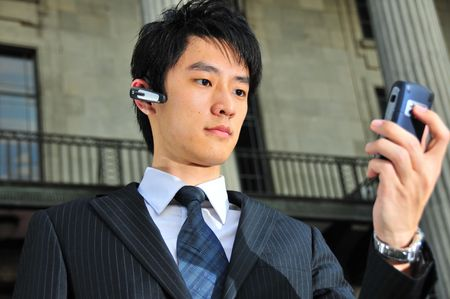 Business Man with PDA phone 1