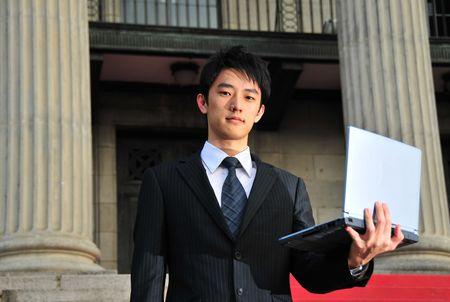 Business Man met persbericht 1 Stockfoto
