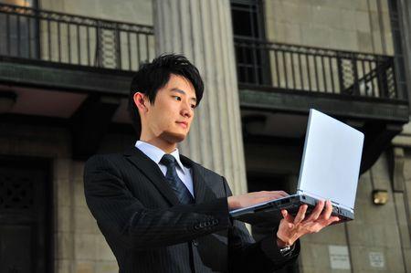 waiting glance: Asian Executive Waiting Stock Photo