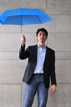 Smart Asian Man With Umbrella Stock Photo