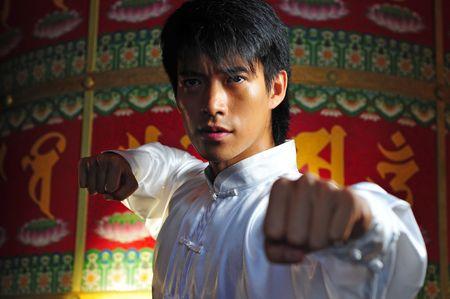 Young Asian Man Training Martial Arts photo