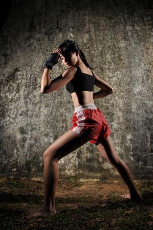 muay: Asian Woman Practising Muay Thai
