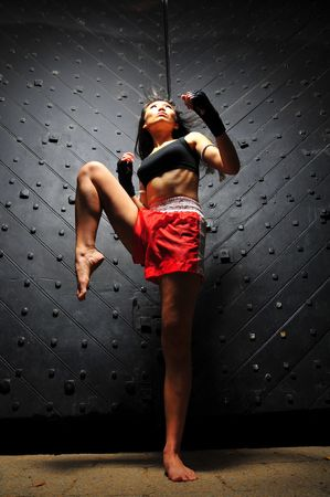 Asian Woman Practising Muay Thai