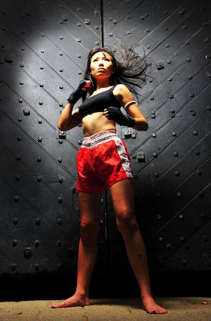 fierce: Sporty Asian Woman Practising Muay Thai