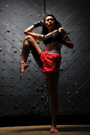 Sporty Asian Woman Practising Muay Thai