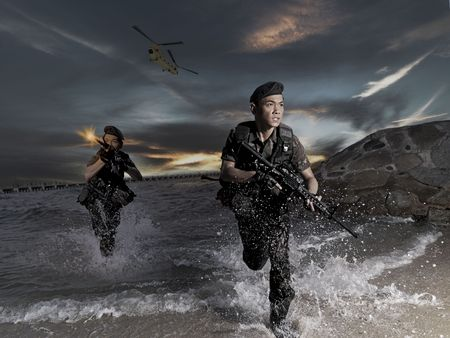 Smart Asian Soldier At The Sea