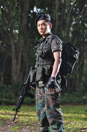 Smart Asian Soldier In The Forest