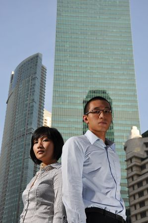 Smart Asian Male and Female Executives Stock Photo