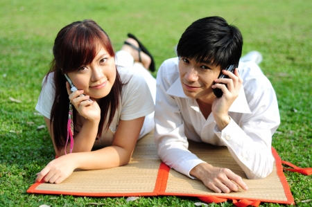 madly: Young Asian Couple in Love  Stock Photo
