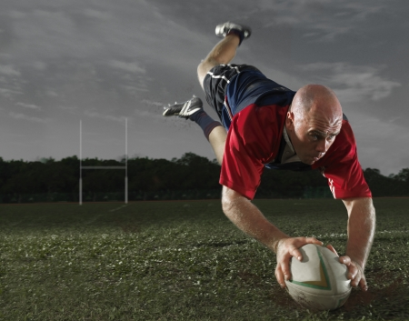rugby ball: Rugby Player making a Score Stock Photo