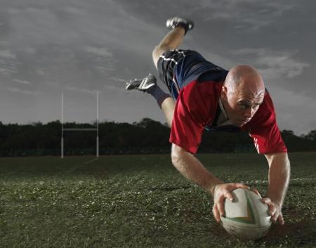 Rugby speler maken een score
