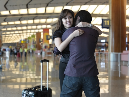 depart: Asian chinese girl being welcomed by loved ones
