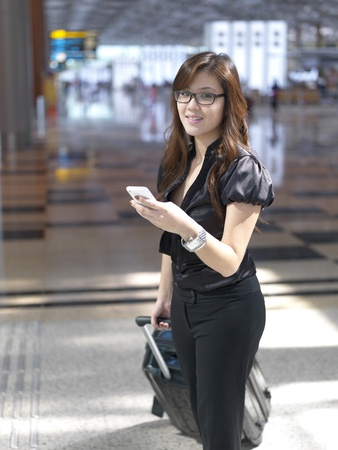 Asian Chinese girl looking up when interrupted at airport