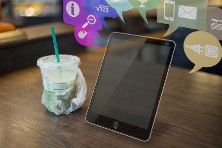 coffee shop: Picture of a futuristic tablet on a table in a coffee chain