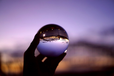 Sunset view of Sydney bridge through crystal ball offering an alternative view