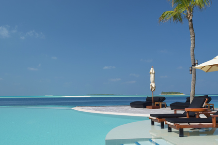 relaxing holiday scene of swimming pool in maldives photo