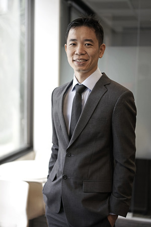 energized: Picture of an successfull asian business male in corporate attire Stock Photo