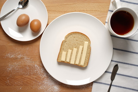 multi grain sandwich: Scene from a breakfast table with staple food showing a graph made of cheese Stock Photo