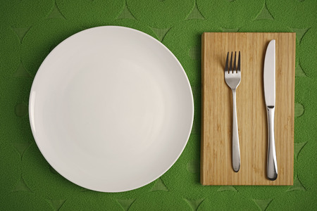contrasty: Modern cutlery on a contrasty green background