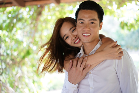 intimate: Asian couple in a close intimate relationship