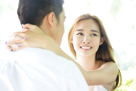 appreciating: Happy asian couple in a happy relationship appreciating each other Stock Photo