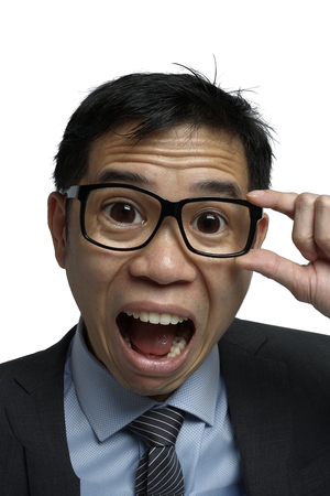 reacting: Asian Salary reacting in a shocked manner Stock Photo