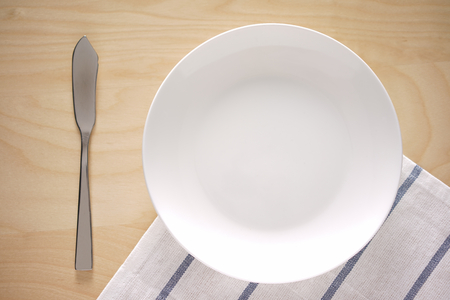 overlaying: Top view of an empty plate on kitchen table, Useful for overlaying text on top Stock Photo