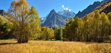 The colorful day in Caucasus mountains of fall photo