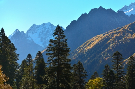 The sunny morning in the mountains Caucasus of the autumn photo