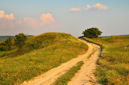 The rural road in Caucasus of summer Stock Photo - 18275314