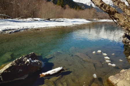 This is transparent water in mountains river photo