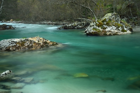 This is transparent river in Caucasus mountains in spring photo