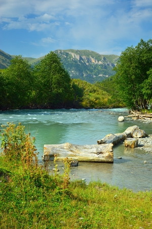 This blue river in Caucasus mountains in summer photo